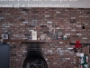 Outdated brick fireplace wall